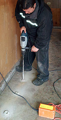 image of Ask the Bug Man Pest Management Company employee carefully using equipment